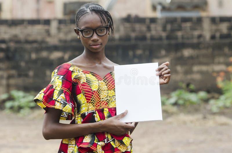 Afrikaans Meisje die haar Thuiswerk tonen royalty-vrije stock foto