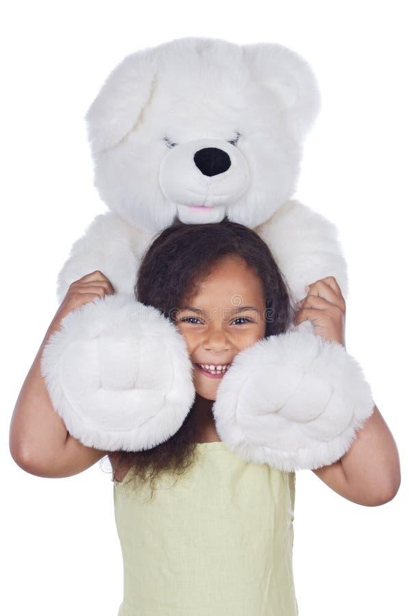 Afrikaans meisje met teddybeer stock foto
