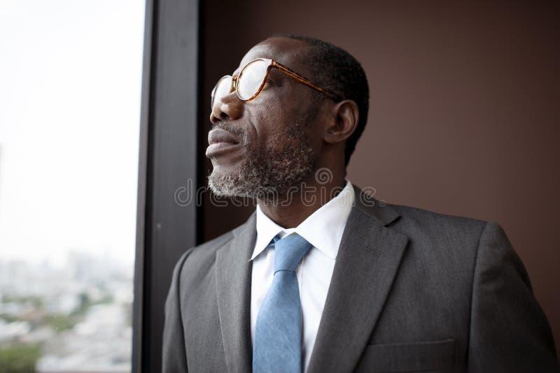 Afrikaanse Afdalingszakenman Contemplation Concept royalty-vrije stock foto