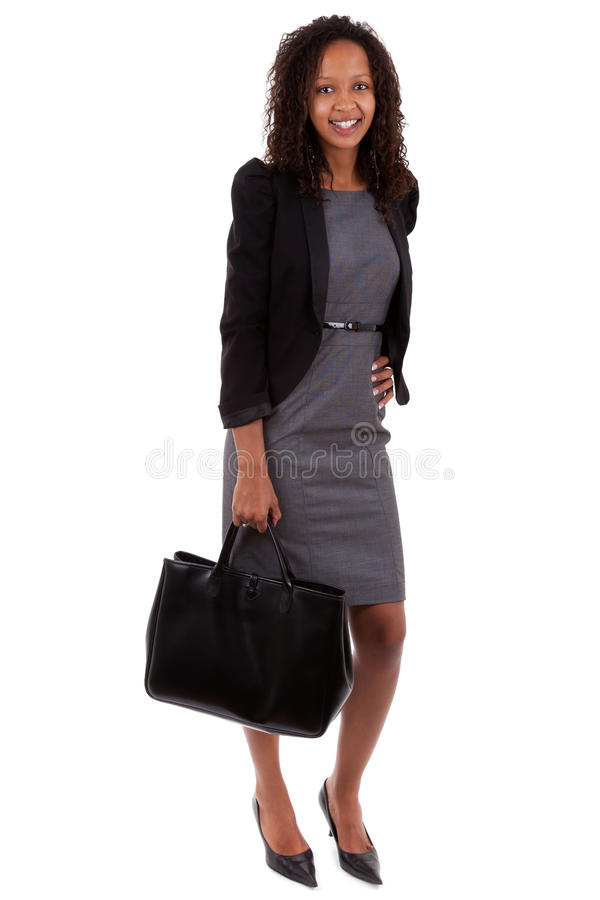 Afrikaanse Amerikaanse bedrijfsvrouw die een handtas houdt stock foto
