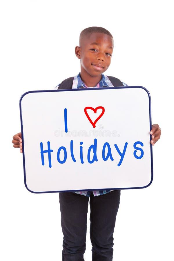 Afrikaanse Amerikaanse schooljongen die een lege raad houden - Zwarte mensen royalty-vrije stock fotografie