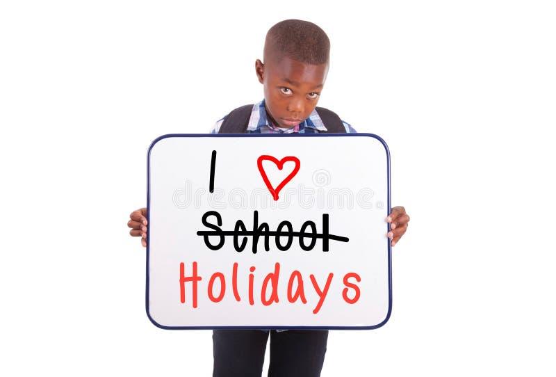 Afrikaanse Amerikaanse schooljongen die een lege raad houden - Zwarte mensen stock fotografie