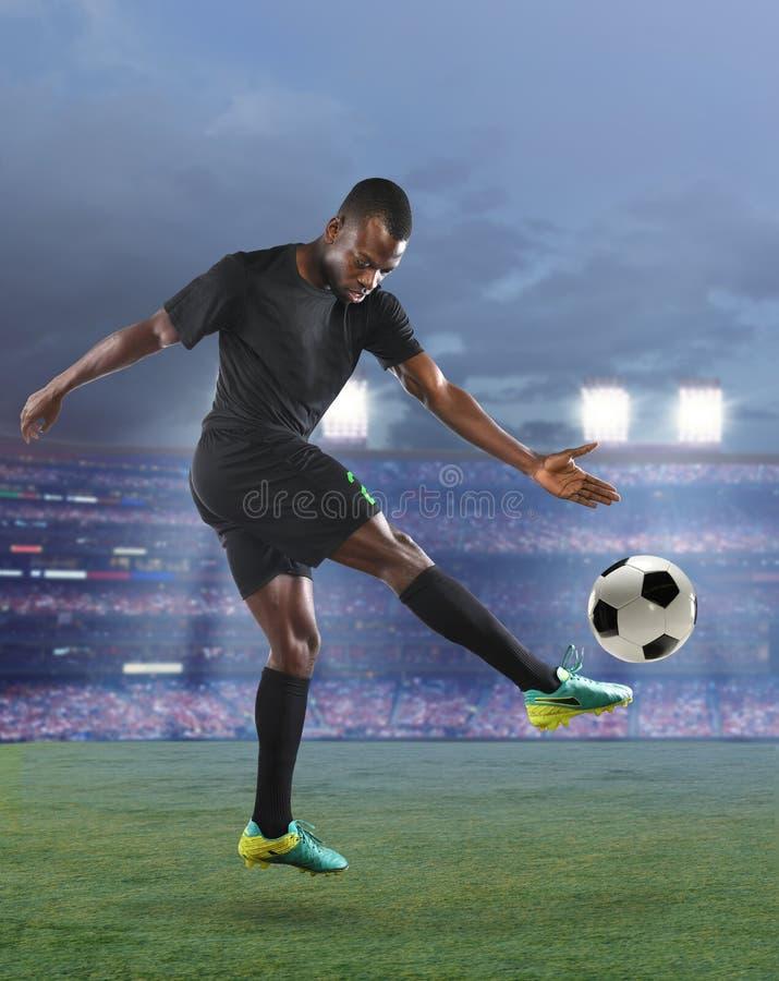 Afrikaanse Amerikaanse Voetballer stock foto