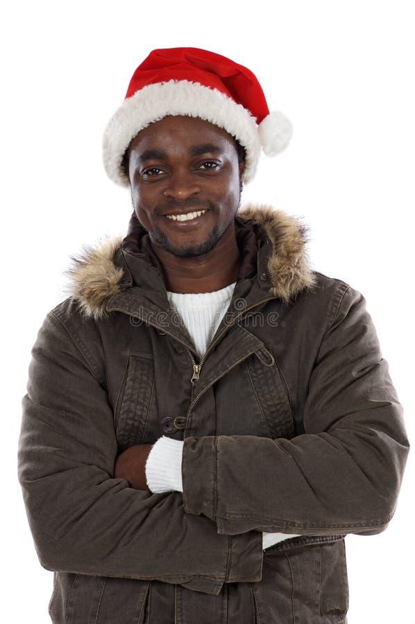 Afrikaanse jongen met de hoed van de Kerstman stock afbeeldingen