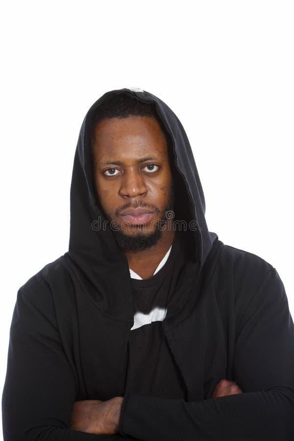 Afrikaanse mens in een zwarte bovenkant met een kap stock afbeeldingen