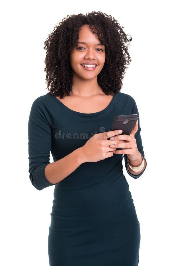 Afrikaanse vrouw bij de telefoon stock afbeeldingen