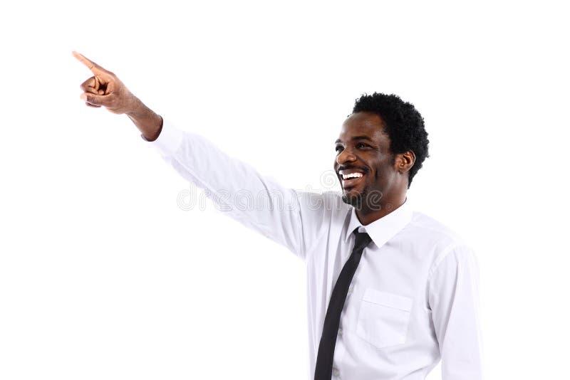 Afrikaanse zakenman die iets voorstelt royalty-vrije stock afbeeldingen