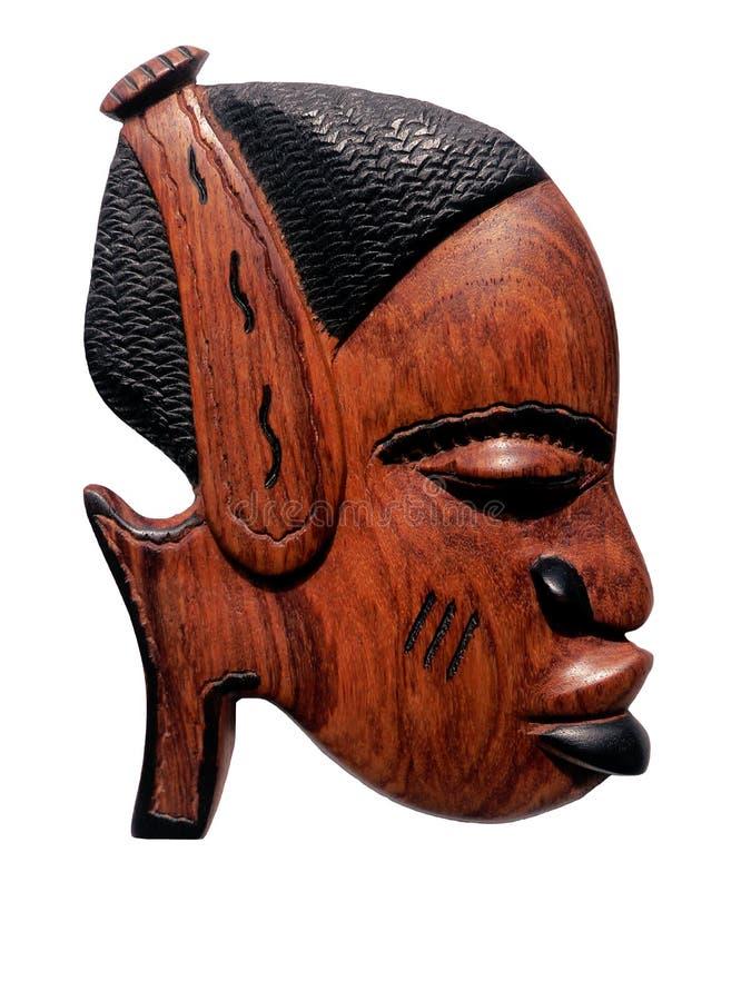 afrikan som snider trä royaltyfria foton