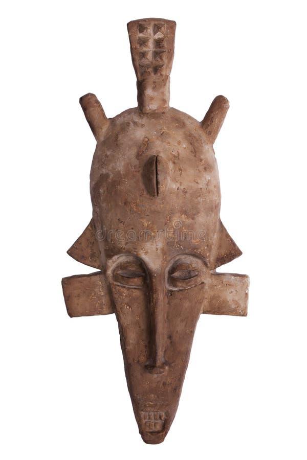 Afrikanische Stammes- Maske der braunen Farbe stockfotos