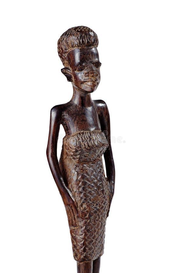 Afrikanische Statue einer Mädchen-Knie-Länge über Whiye lizenzfreies stockbild