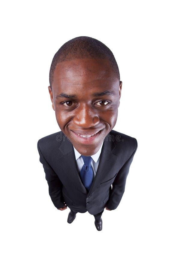 Afrikanischer Geschäftsmann, der zu Ihnen lächelt lizenzfreie stockfotografie