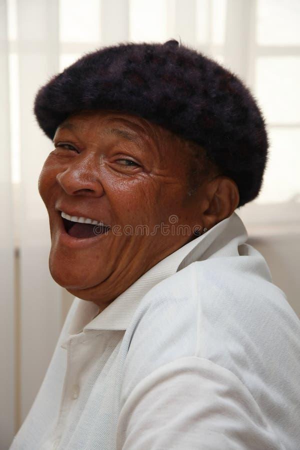 Afrikanisches Frauen-Lachen lizenzfreie stockbilder