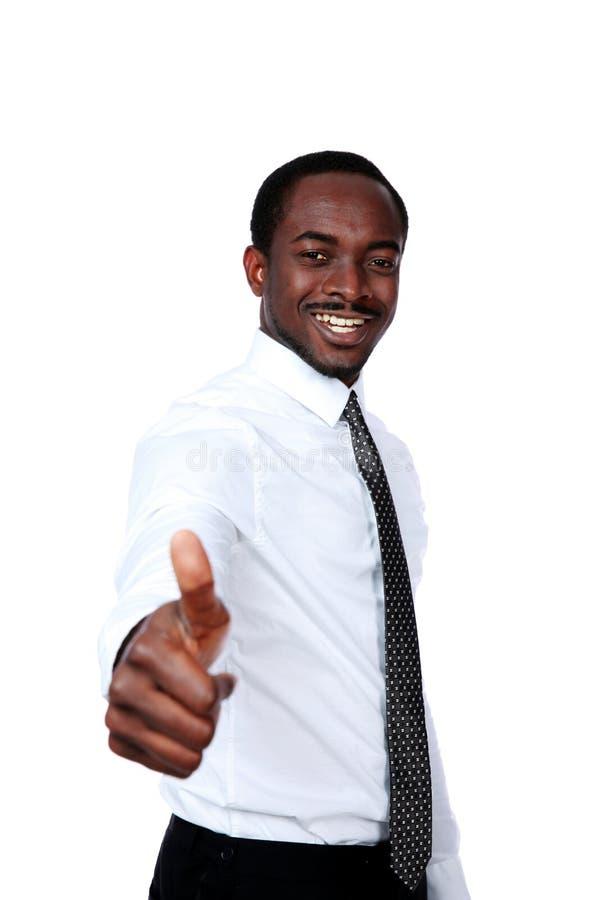 Afrikansk affärsmanvisningtumme upp arkivfoton