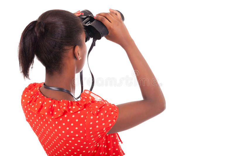 Afrikansk amerikan genom att använda kikare som isoleras över vitbakgrund fotografering för bildbyråer