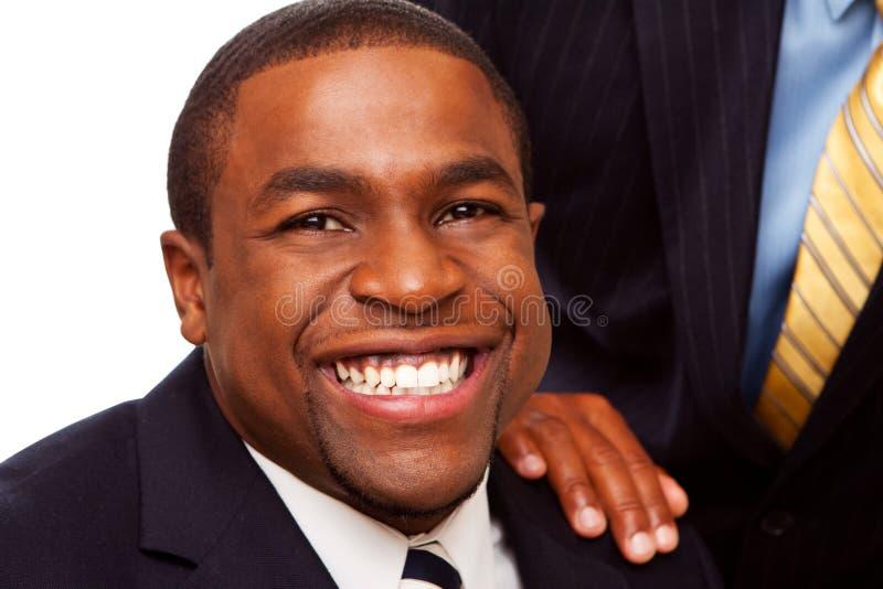 Afrikansk amerikanaffärslag och mentor royaltyfria bilder