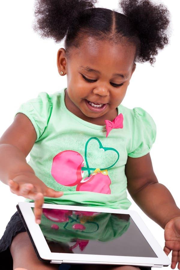 afrikansk amerikanflicka little använda för PCtablet royaltyfria foton