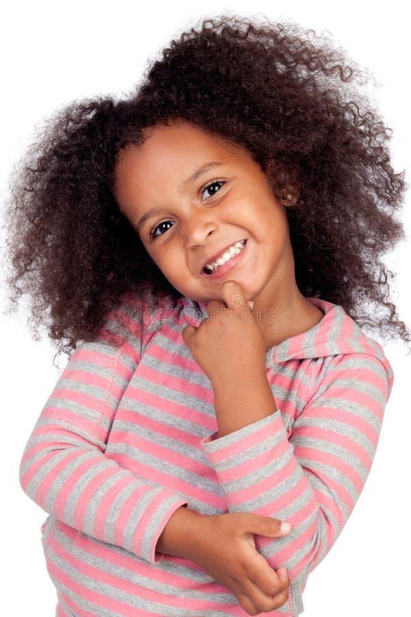 afrikansk flicka little som är eftertänksam arkivbild
