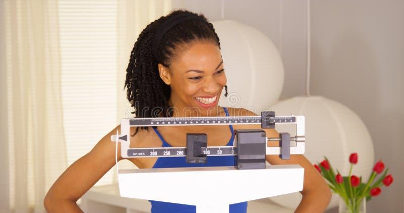 Afrikansk kvinna som känner sig mycket stolt av henne royaltyfria foton