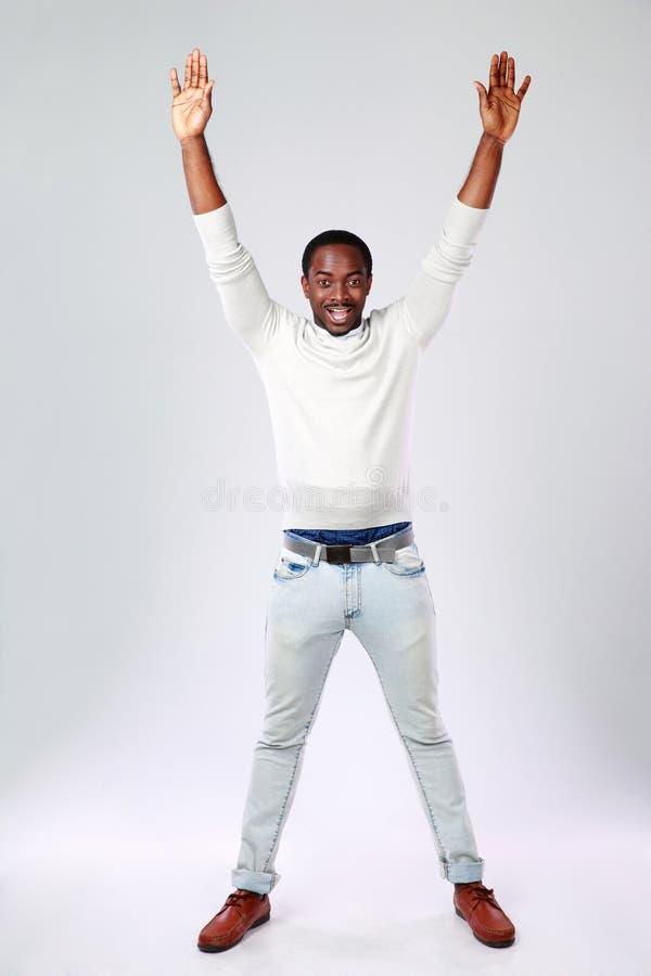 Afrikansk man med lyftta händer royaltyfria bilder