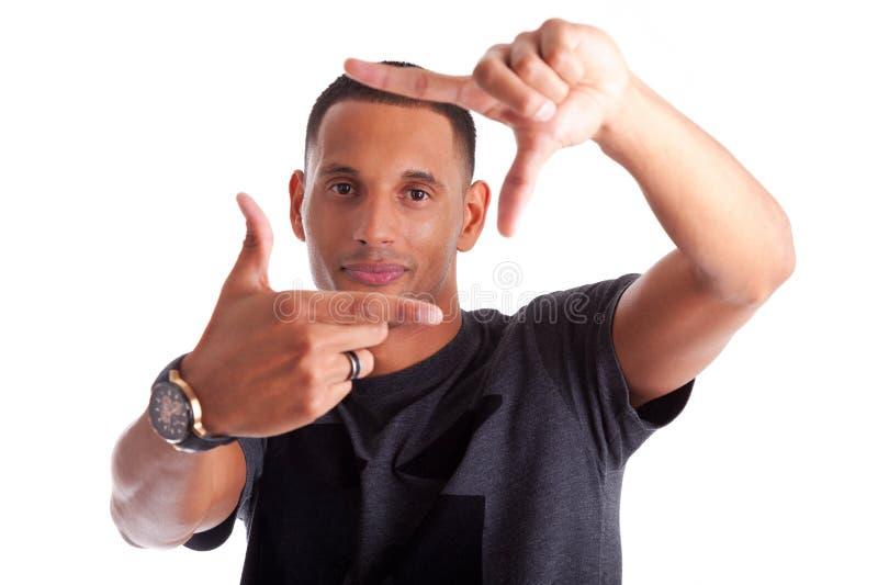 Download Afrikansk Man Som Gör Ramtecknet Med Hans Händer Fotografering för Bildbyråer - Bild av amerikansk, begrepp: 27277187