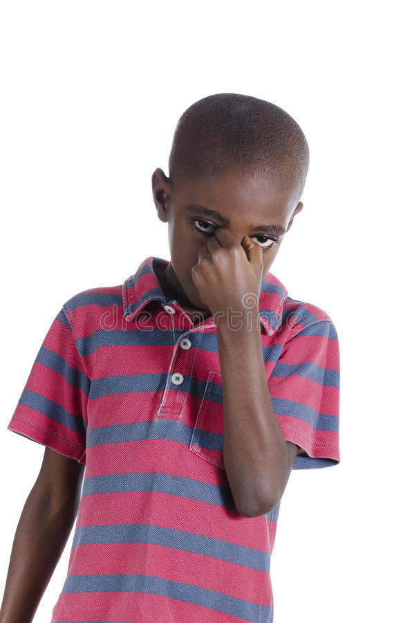 Afrikansk pojke i spänning royaltyfria bilder