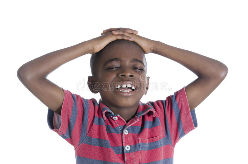 Afrikansk pojke i spänning royaltyfri foto