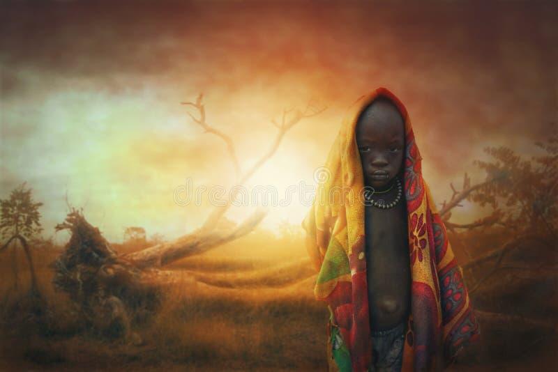 Afrikansk pojke Mursi fotografering för bildbyråer