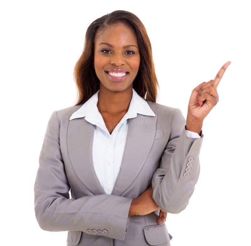 Afrikanskt peka för affärskvinna arkivfoto
