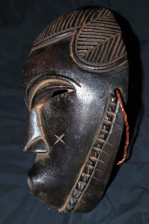 Afrikanskt stam- maskerar - den Songe stammen arkivbilder