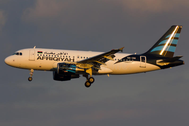 Afriqiyah Airbus A319 Plane. In the sky 5A-ONI royalty free stock images