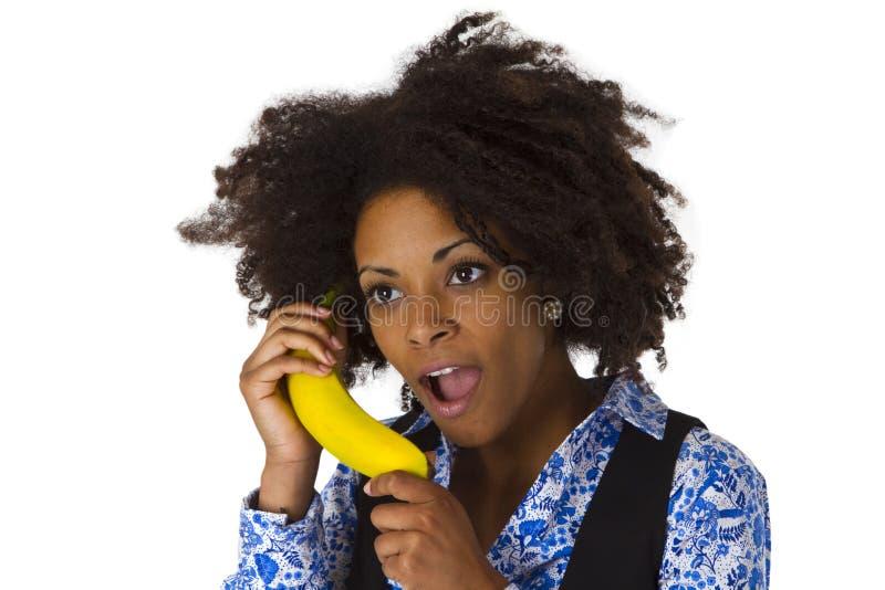 Afro-américain féminin avec la banane photographie stock