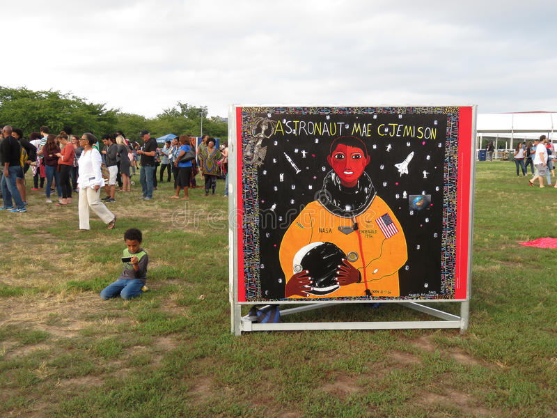 Afro American Astronaut. Photo of people and poster of an afro american astronaut at the celebration on the washington monument grounds of the opening of the stock photos