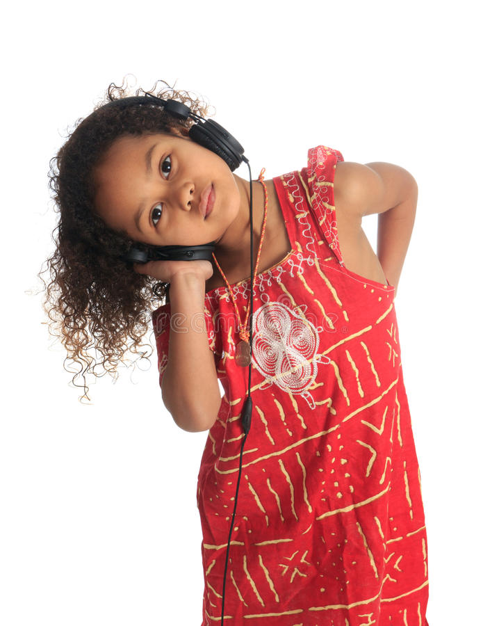 Afro american black asian beautiful children hair. Afro american black asian beautiful girl with curly hair listening to music isolated girl metisse asiatique stock images