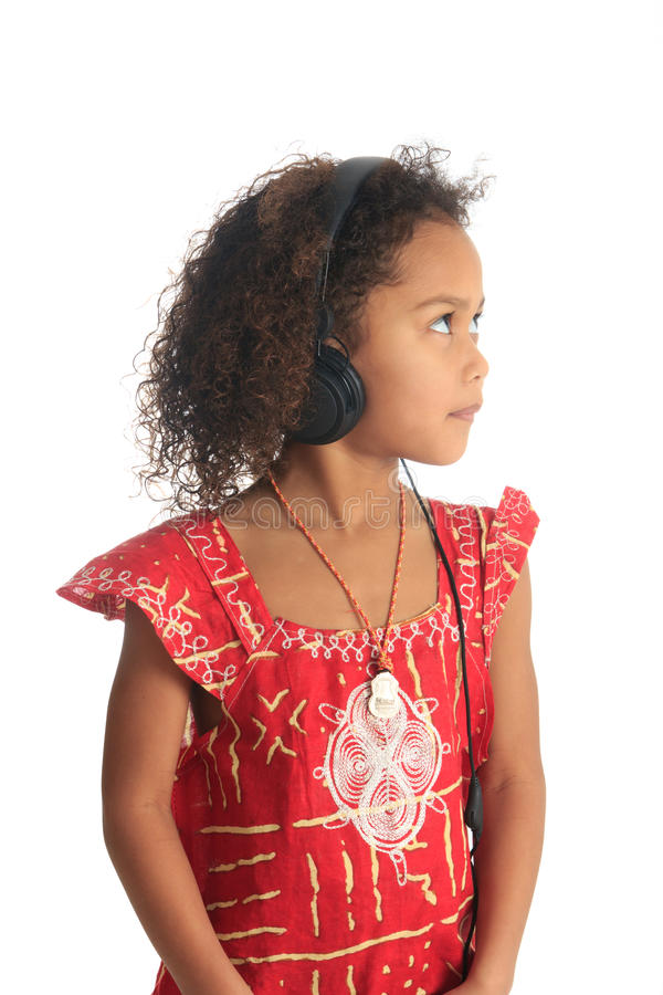 Afro american black asian beautiful children hair. Afro american black asian beautiful girl with curly hair listening to music isolated girl metisse asiatique royalty free stock photography