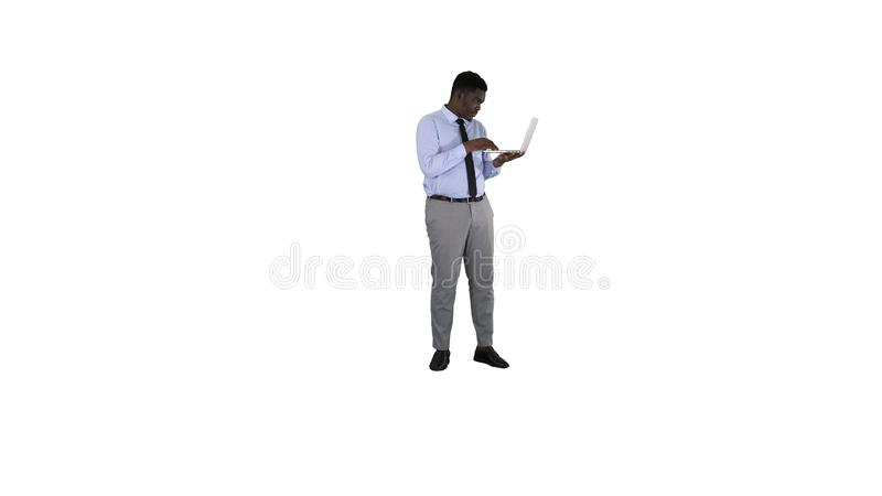 Afro American business man working with laptop on white background. stock images