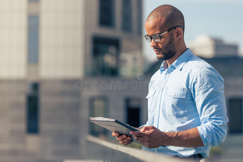Afro American businessman with gadget royalty free stock photo