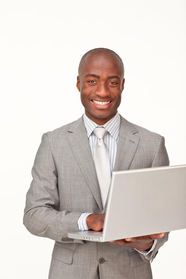 Afro-American businessman using a laptop stock images