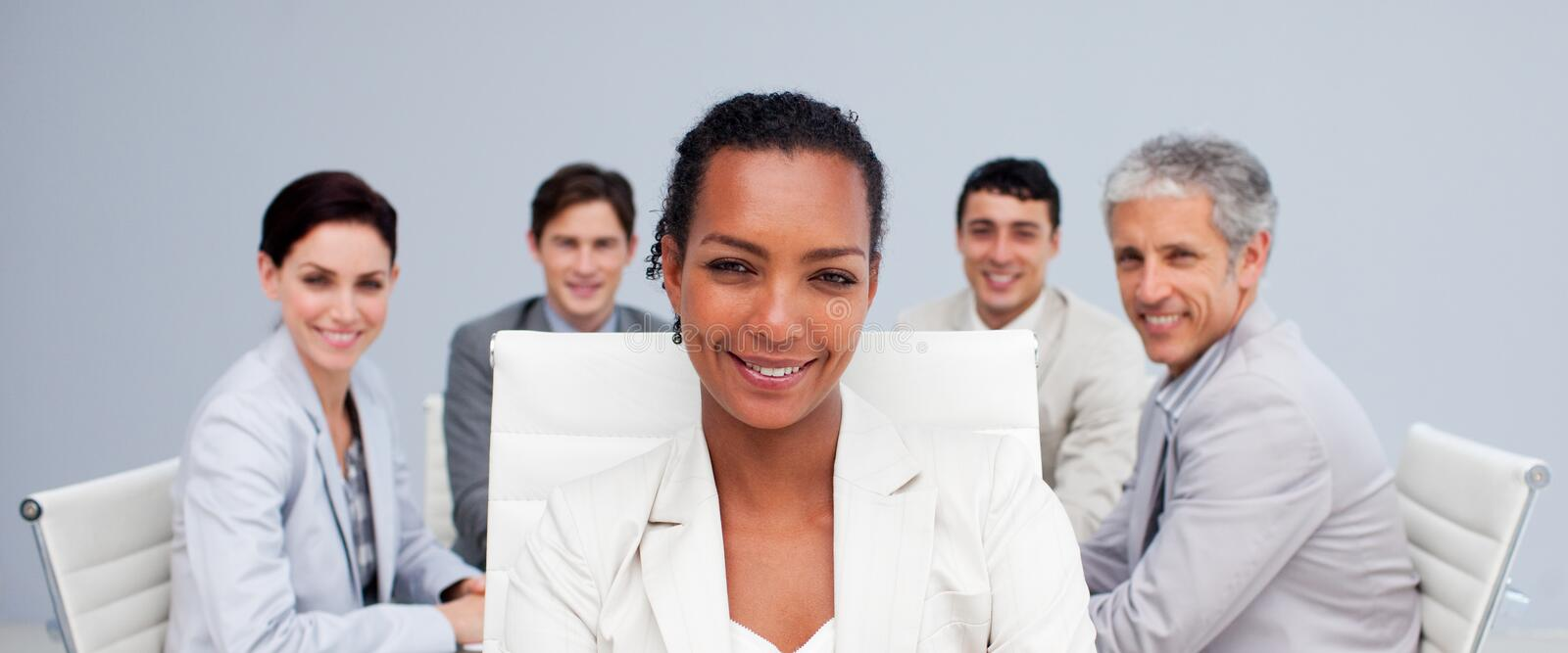 Afro-American businesswoman smiling in a meeting stock photography