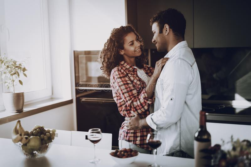 Afro American Couple Hang Each Other In Kitchen. royalty free stock images