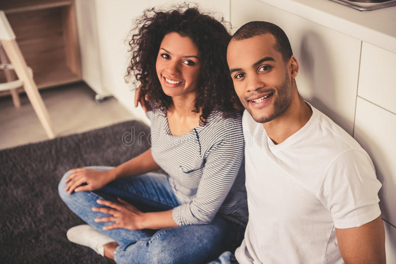 Afro American couple in kitchen stock photos