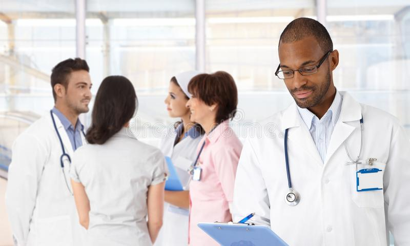 Afro-american doctor and medical team royalty free stock images