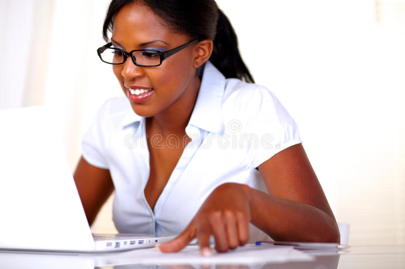 Afro-american female studying royalty free stock photography
