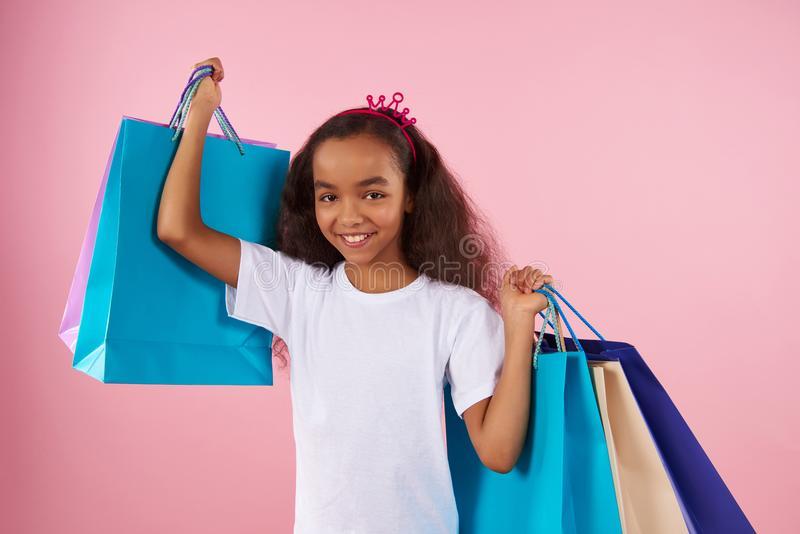 Afro American girl in sham crown holds paper royalty free stock photo