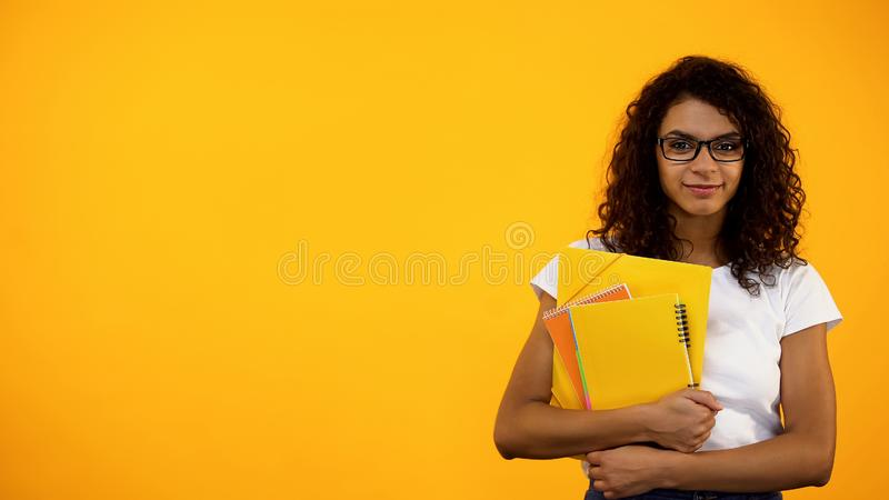 Afro-American girl standing with books, international student exchange programs. Stock photo royalty free stock photos