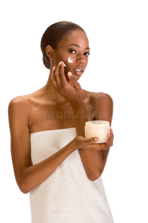 Download Afro-American Girl Wrapped In Towel Putting Cream Stock Photo - Image: 6160736