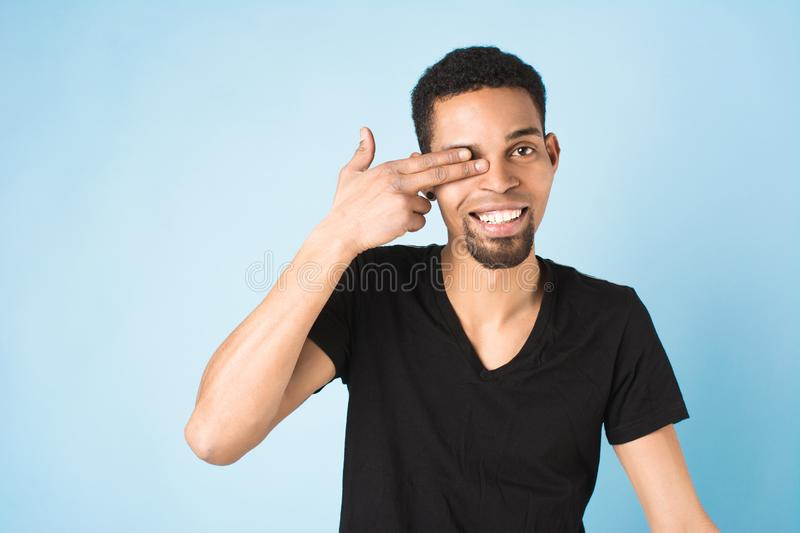Afro american guy in black t-shirt stock photo