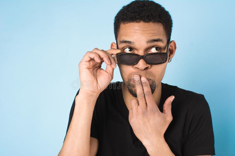 Afro american guy in black t-shirt and sunglasses stock photos