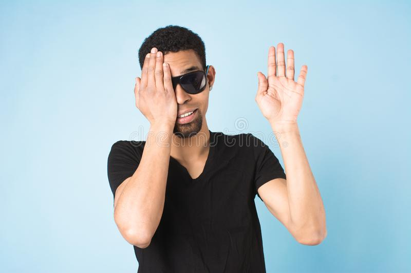 Afro american guy in black t-shirt and sunglasses stock image