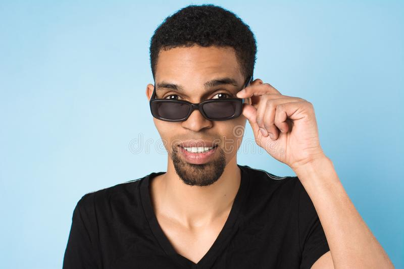 Afro american guy in black t-shirt and sunglasses stock images