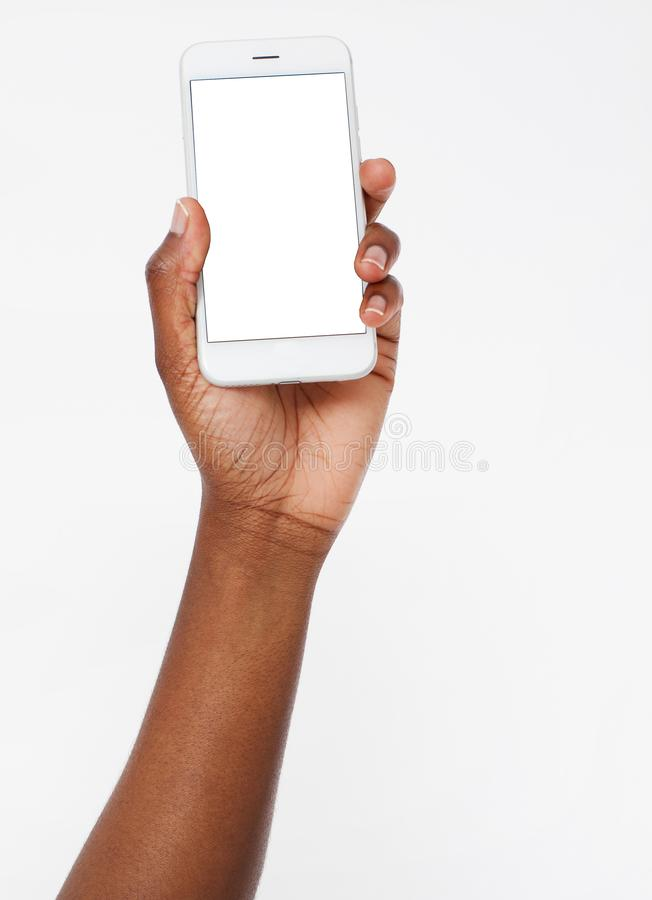 Free Afro American Hand Hold Blank Screen Phone Isolated On White Background,mobile Apps. Black Arm. Top View.Mock Up.Copy Spacе Stock Photography - 130004922